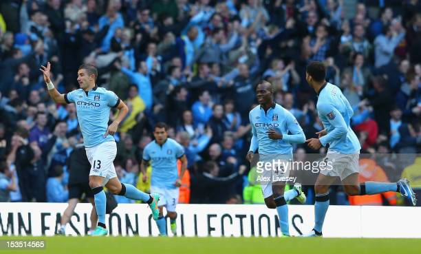 Aleksandar Kolarov of Manchester City celebrates scoring the opening goal during the Barclays Premier League match between Manchester City and...