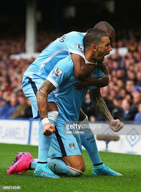 Aleksandar Kolarov of Manchester City celebrates scoring the opening goal with Fernandinho of Manchester City during the Barclays Premier League...