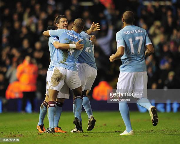 Aleksandar Kolarov of Manchester City celebrates with teammates after scoring during the Barclays Premier League match between Birmingham City and...