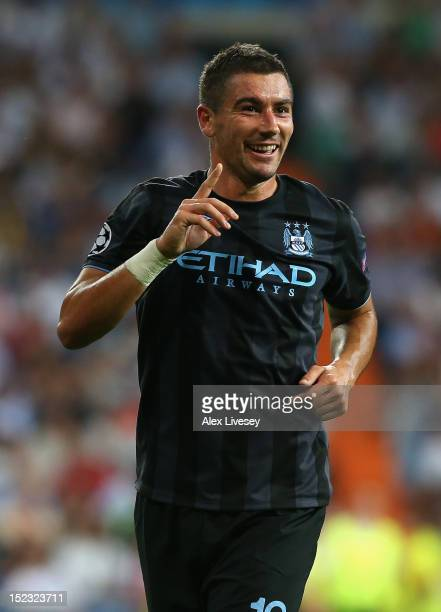 Aleksandar Kolarov of Manchester City FC celebrates after scoring his goal during the UEFA Champions League Group D match between Real Madrid and...