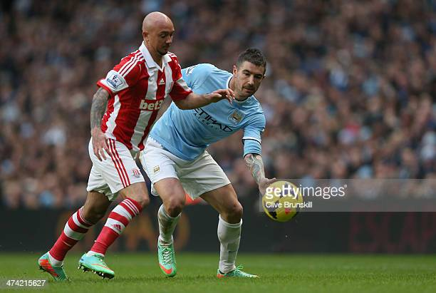 Aleksandar Kolarov of Manchester City in action with Stephen Ireland of Stoke City during the Barclays Premier League match between Manchester City...