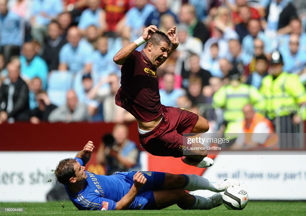 Aleksandar Kolarov of Manchester City is tackled by Branislav Ivanovic of Chelsea during the FA Community Shield match between Manchester City and Chelsea at Villa Park on August 12, 2012 in Birmingham, England.