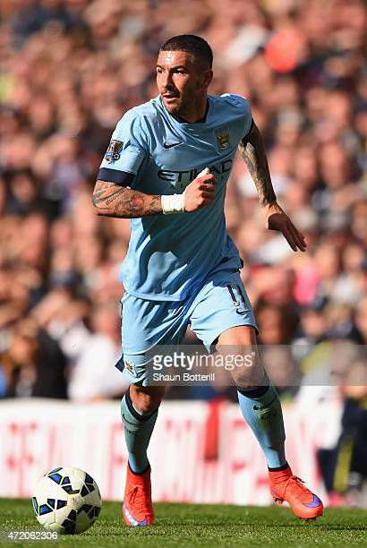 Aleksandar Kolarov of Manchester City runs with the ball during the Barclays Premier League match between Tottenham Hotspur and Manchester City at...