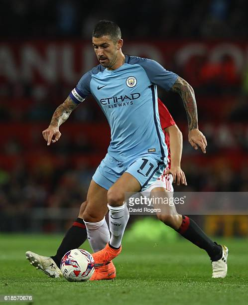 Aleksandar Kolarov of Manchester City runs with the ball during the EFL Cup Fourth Round match between Manchester United and Manchester City at Old...