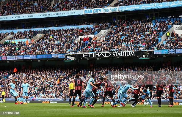 Aleksandar Kolarov of Manchester City scores his team's second goal from a free kick during the Barclays Premier League match between Manchester City...