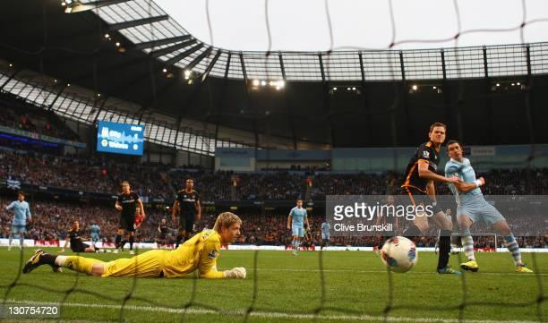 Aleksandar Kolarov of Manchester City scores the second goal during the Barclays Premier League match between Manchester City and Wolverhampton...
