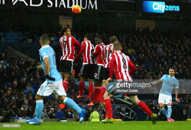 Aleksandar Kolarov of Manchester City takes a free kick during the Barclays Premier League match between Manchester City and Southampton at the...