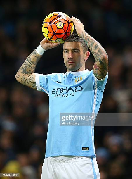 Aleksandar Kolarov of Manchester City takes a throw in during the Barclays Premier League match between Manchester City and Southampton at Etihad...