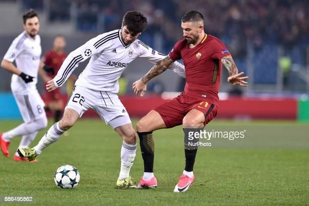 Aleksandar Kolarov of Roma is challenged by Afran Ismayilov of Qarabag during the UEFA Champions League match between Roma and Qarabag at Stadio...