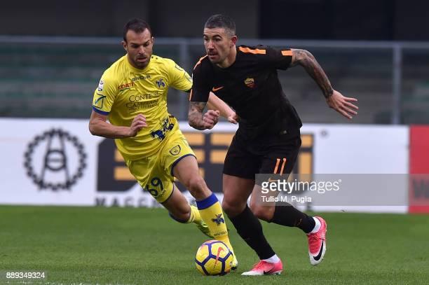 Aleksandar Kolarov of Roma is challenged by Riccardo Meggiorini of Chievo Verona during the Serie A match between AC Chievo Verona and AS Roma at...
