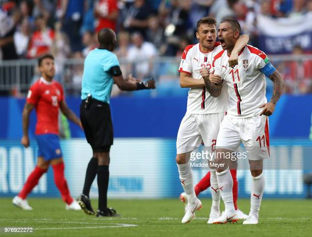 Aleksandar Kolarov of Serbia celebrates with teammate Adem Ljajic after scoring his team's first goal during the 2018 FIFA World Cup Russia group E...