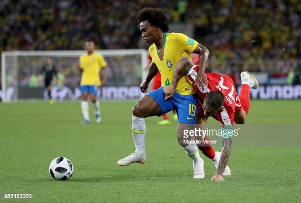 Aleksandar Kolarov of Serbia challenes Willian of Brazil during the 2018 FIFA World Cup Russia group E match between Serbia and Brazil at Spartak...