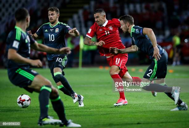 Aleksandar Kolarov of Serbia in action against Chris Gunter and Aaron Ramsey of Wales during the FIFA 2018 World Cup Qualifier between Serbia and...