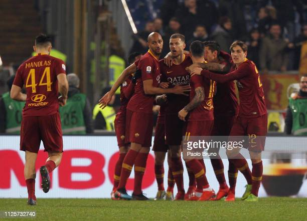 Aleksandar Kolarov with his teammates of AS Roma celebrates after scoring the opening goal from penalty spot during the Serie A match between AS Roma...