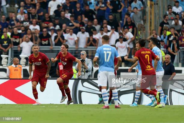 Aleksandar Kolarov with his teammates of AS Roma celebrates after scoring the opening goal from penalty spot during the Serie A match between SS...
