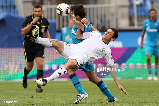 Aleksandar Lukovic of FC Zenit St Petersburg battles for the ball with Goran Maznov of FC Tom Tomsk during the Russian Football League Championship...