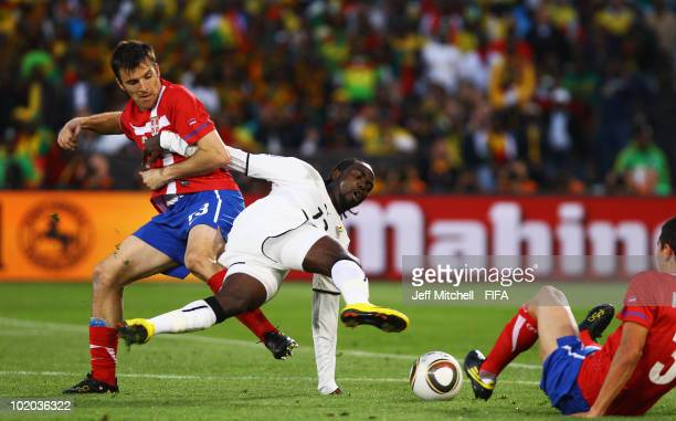 Aleksandar Lukovic of Serbia tackles Prince Tagoe of Ghana and is shown a red card and sent off by referee Hector Baldassi during the 2010 FIFA World...