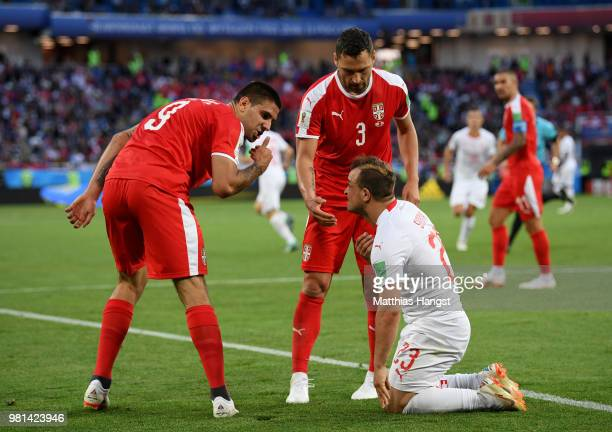 Aleksandar Mitrovic and Dusko Tosic of Serbia argue with Xherdan Shaqiri of Switzerland during the 2018 FIFA World Cup Russia group E match between...
