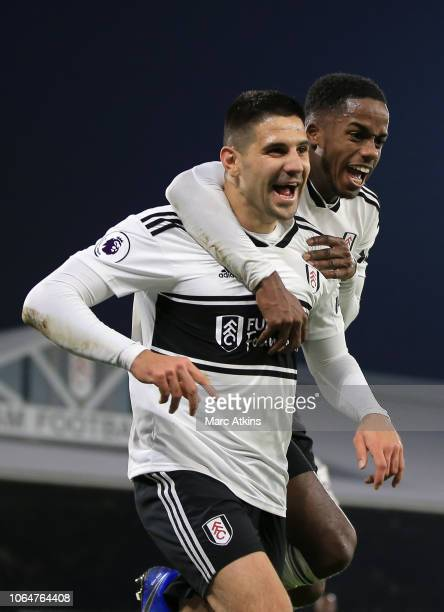 Aleksandar Mitrovic celebrates after scoring his team's third goal with teammate Ryan Sessegnon of Fulham during the Premier League match between...