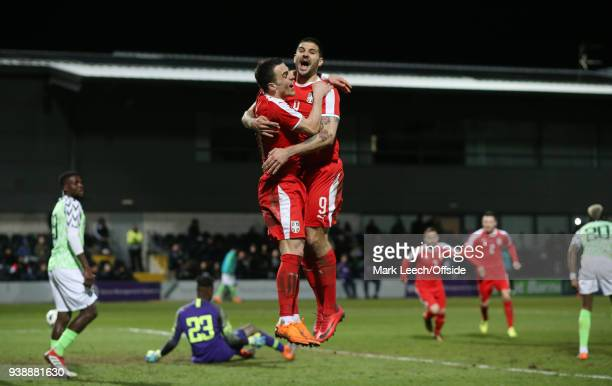Aleksandar Mitrovic celebrates his second goal for Serbia with Filip Kosticduring the International Friendly match between Nigeria and Serbia at The...