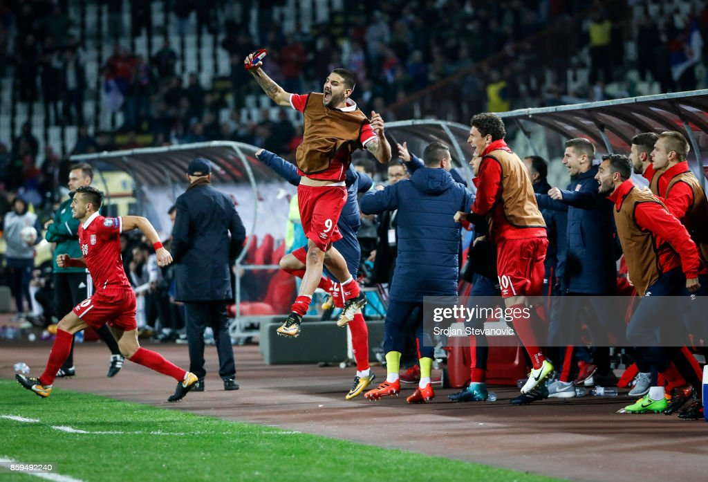 Aleksandar Mitrovic (C) Dusan Tadic (L) and Milos Veljkovic (R) of Serbia celebrates the victory after FIFA 2018 World Cup Qualifier between Serbia and Georgia at stadium Rajko Mitic on October 9, 2017 in Belgrade.