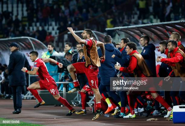 Aleksandar Mitrovic Dusan Tadic and Milos Veljkovic of Serbia celebrate their victory after the FIFA 2018 World Cup Qualifier between Serbia and...