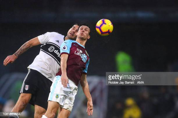 Aleksandar Mitrovic of Fulham and Jack Cork of Burnley during the Premier League match between Burnley FC and Fulham FC at Turf Moor on January 12...