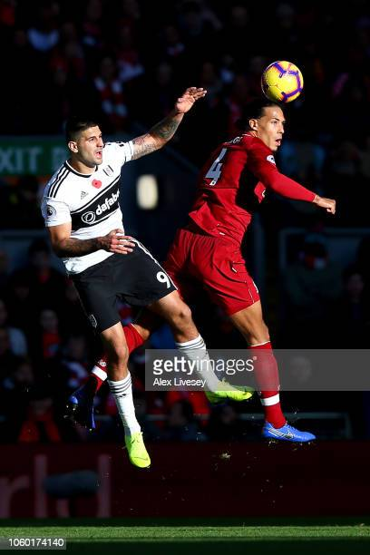 Aleksandar Mitrovic of Fulham battles for possession with Virgil van Dijk of Liverpool during the Premier League match between Liverpool FC and...