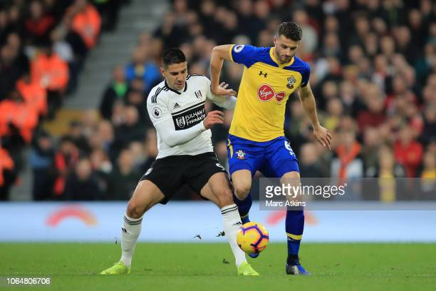 Aleksandar Mitrovic of Fulham battles for possession with with Wesley Hoedt of Southampton during the Premier League match between Fulham FC and...