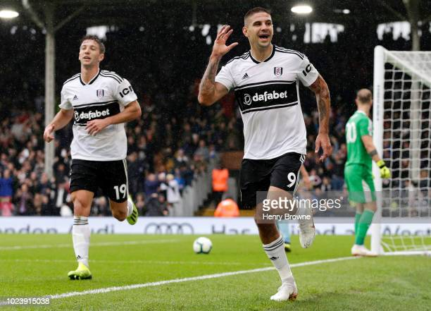 Aleksandar Mitrovic of Fulham celebrates after scoring his team's second goal during the Premier League match between Fulham FC and Burnley FC at...