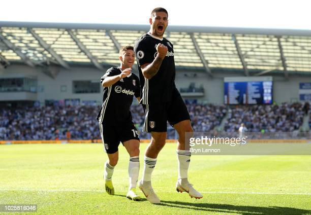 Aleksandar Mitrovic of Fulham celebrates after scoring his team's second goal during the Premier League match between Brighton Hove Albion and Fulham...