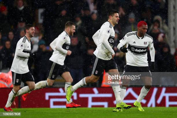 Aleksandar Mitrovic of Fulham celebrates after scoring his team's second goal with his team mates during the Premier League match between Fulham and...