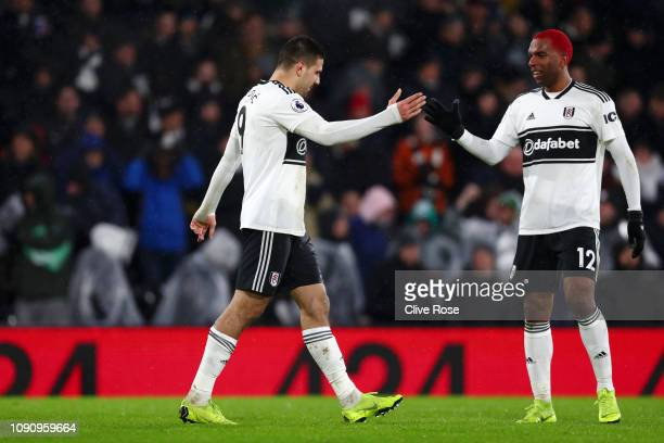 Aleksandar Mitrovic of Fulham celebrates after scoring his team's third goal with Ryan Babel of Fulham during the Premier League match between Fulham...