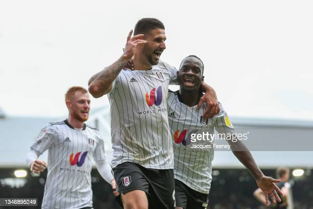 Aleksandar Mitrovic of Fulham celebrates after scoring their side's second goal during the Sky Bet Championship match between Fulham and Queens Park...