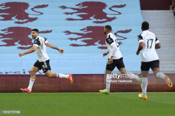 Aleksandar Mitrovic of Fulham celebrates after scoring their team's first goal during the Premier League match between Aston Villa and Fulham at...