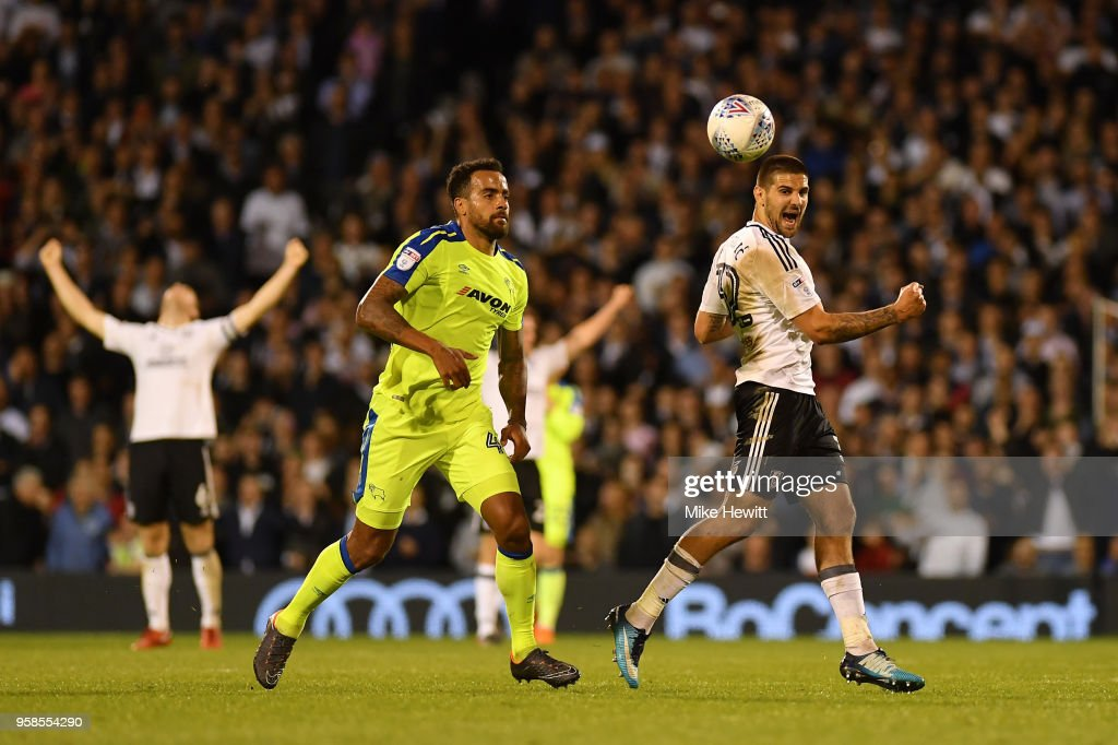 Aleksandar Mitrovic of Fulham (R) celebrates at the final whistle during the Sky Bet Championship Play Off Semi Final, second leg match between Fulham and Derby County at Craven Cottage on May 14, 2018 in London, England.