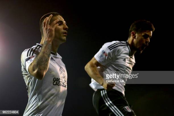 Aleksandar Mitrovic of Fulham celebrates scoring his sides second goal alongside Rui Fonte of Fulham during the Sky Bet Championship match between...