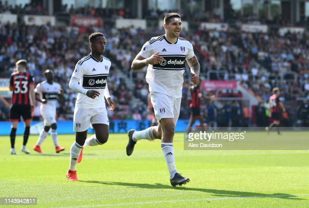 Aleksandar Mitrovic of Fulham celebrates with team mates after scoring their team's first goal from the penalty spot during the Premier League match...