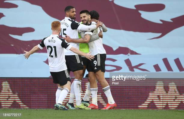 Aleksandar Mitrovic of Fulham celebrates with team mates Ruben Loftus-Cheek and Harrison Reed after scoring their sides first goal during the Premier...