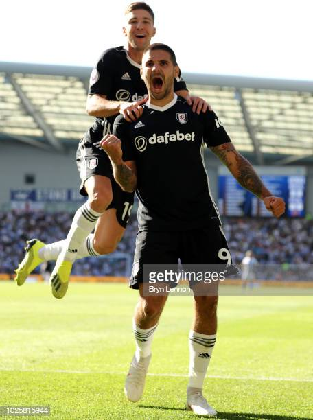 Aleksandar Mitrovic of Fulham celebrates with teammate Luciano Vietto after scoring his team's second goal during the Premier League match between...