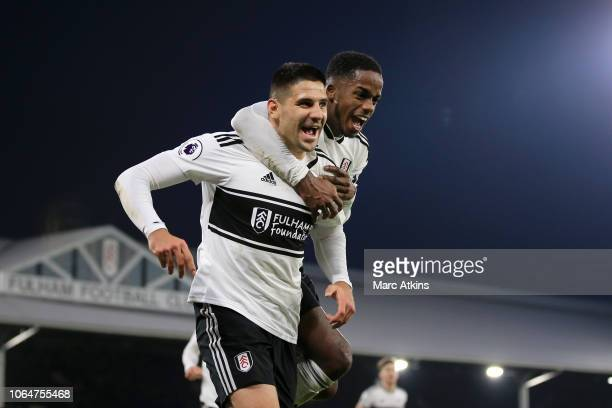 Aleksandar Mitrovic of Fulham celebrates with teammate Ryan Sessegnon after scoring his team's third goal during the Premier League match between...