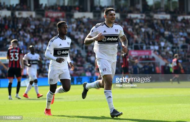 Aleksandar Mitrovic of Fulham celebrates with teammates after scoring his teams first goal during the Premier League match between AFC Bournemouth...