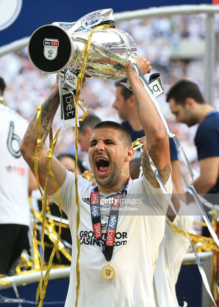 Aleksandar Mitrovic of Fulham celebrates with the trophy during the Sky Bet Championship Play Off Final between Aston Villa and Fulham at Wembley Stadium on May 26, 2018 in London, England.