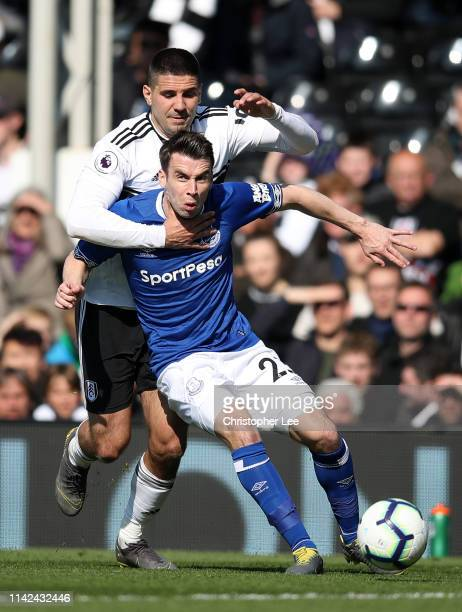 Aleksandar Mitrovic of Fulham challenges Seamus Coleman of Everton during the Premier League match between Fulham FC and Everton FC at Craven Cottage...