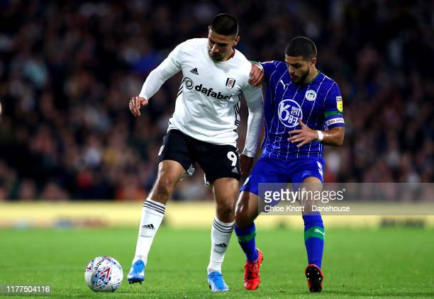 Aleksandar Mitrovic of Fulham FC and Sam Sayed Morsy of Wigan Athletic induring the Sky Bet Championship match between Fulham and Wigan Athletic at...