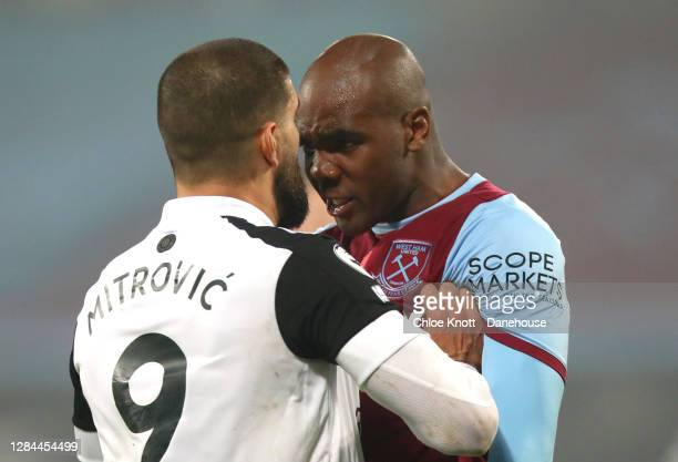 Aleksandar Mitrovic of Fulham FC argues with Angelo Ogbonna of West Ham United during the Premier League match between West Ham United and Fulham at...