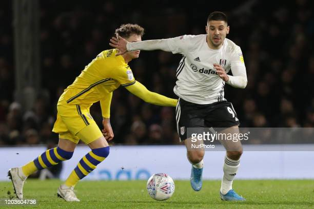 Aleksandar Mitrovic of Fulham getting past Joe Rodon of Swansea City during the Sky Bet Championship match between Fulham and Swansea City at Craven...