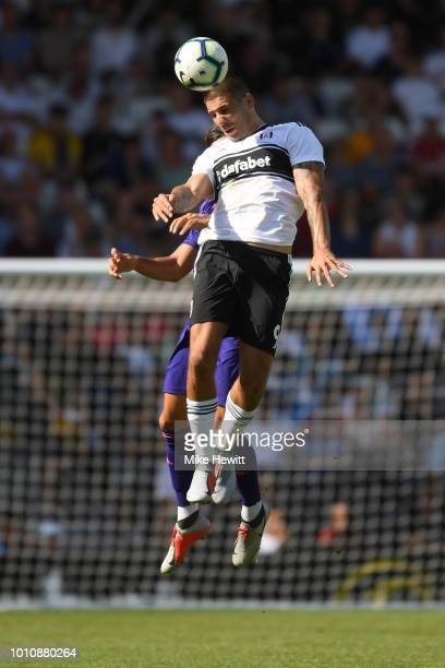 Aleksandar Mitrovic of Fulham heads the ball during a PreSeason Friendly between Fulham and Celta Vigo at Craven Cottage on August 4 2018 in London...
