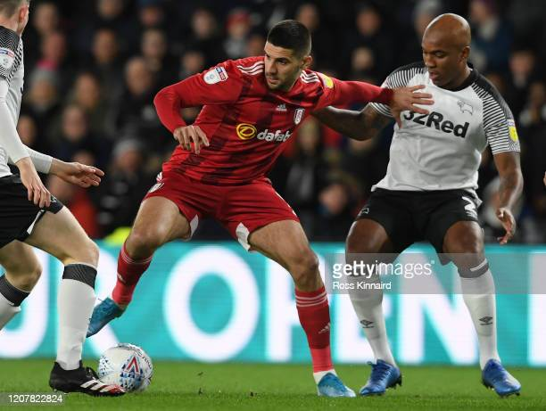 Aleksandar Mitrovic of Fulham holds off Andre Wisdom of Derby during the Sky Bet Championship match between Derby County and Fulham at Pride Park...