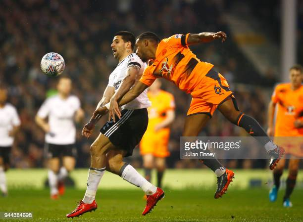 Aleksandar Mitrovic of Fulham is challenged by Liam Moore of Reading during the Sky Bet Championship match between Fulham and Reading at Craven...